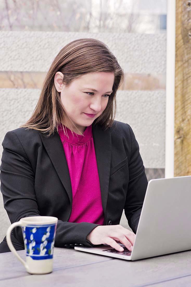 Julie working on her laptop